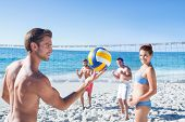 image of volleyball  - Friends playing volleyball at the beach - JPG