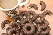image of biscuits  - Coffee and delicious chocolate biscuits on table closeup - JPG