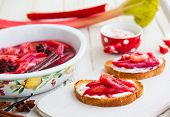 stock photo of ginger bread  - Toasted bread with yogurt and top with syrupy spiced rhubarb - JPG