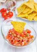 stock photo of nachos  - Bowl of fresh homemade salsa dip with nachos - JPG