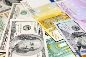 stock photo of two dollar bill  - Background of euro and dollar bills - JPG