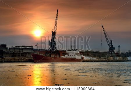 Cargo Ship Loading In Port At The Sunrise
