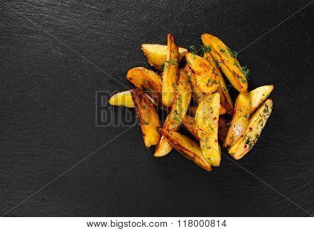Potato Wedges On Black Background.
