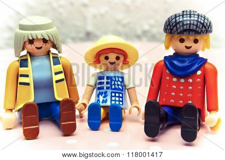Toy family: mother, father and their child.