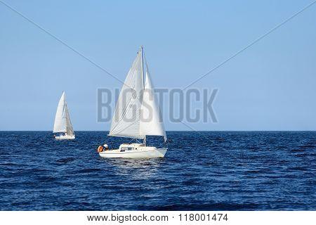 Two White Sail Yachts Sailing. Riga, Latvia