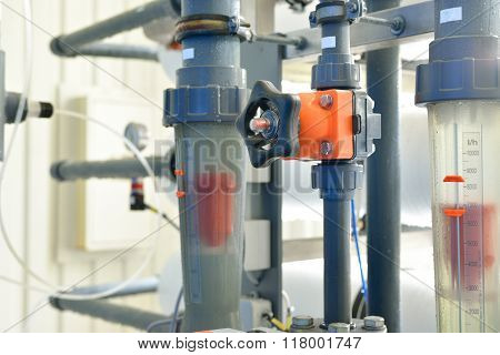 Industrial Levels And Water Pipes In Boiler Room