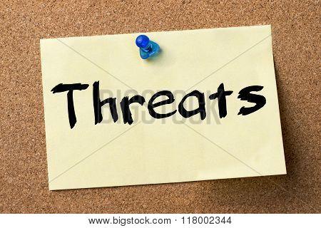 Threats - Adhesive Label Pinned On Bulletin Board