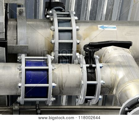 Large new metal pipes in an industrial boiler room