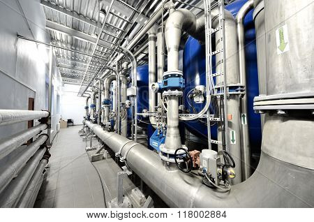 Large Industrial Boiler Room Interior With Pipes