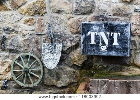 Gold mining tools on a stone wall