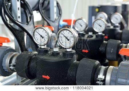 Industrial Barometer In Boiler Room with orange vents