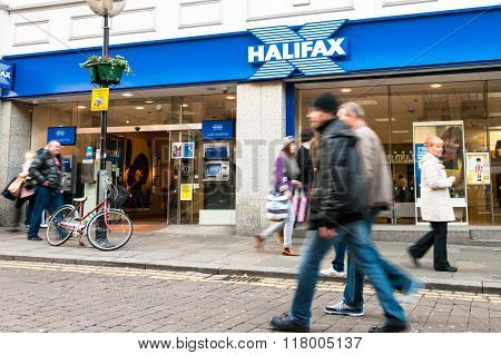 People Walk Past a Branch of the Halifax Bank in Liverpool
