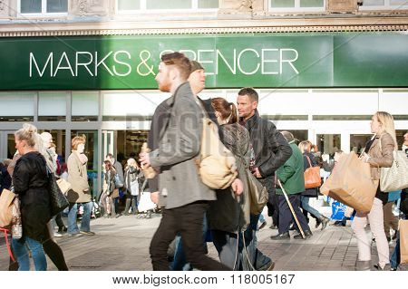 People Walk Past a Branch of Marks and Spencer in Liverpool