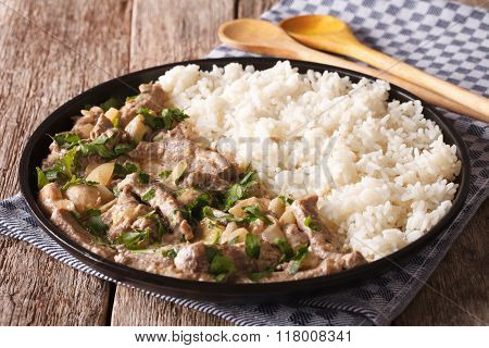 Russian Cuisine: Beef Stroganoff With Rice Close-up On A Plate. Horizontal