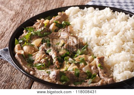Beef Stroganoff Garnished With Rice Close-up On A Plate. Horizontal