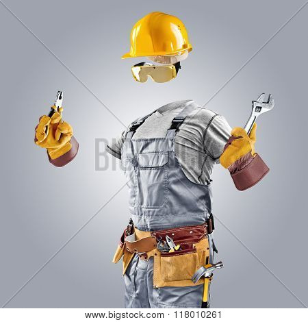 invisible builder with wrench and pliers