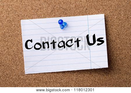 Contact Us - Teared Note Paper  Pinned On Bulletin Board