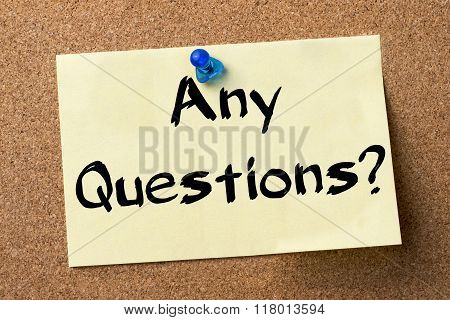Any Questions? - Adhesive Label Pinned On Bulletin Board