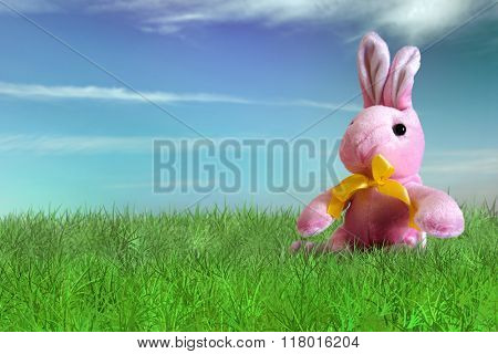 Pink bunny plush on grass on backyard - Happy Easter