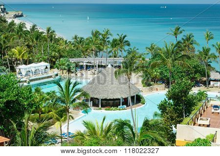 Amazing view above the tropical garden pool and tranquil beautiful turquoise ocean