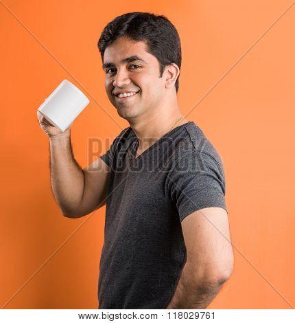 indian man with coffee mug, indian man drinking coffee, indian man drinking tea, asian man having te