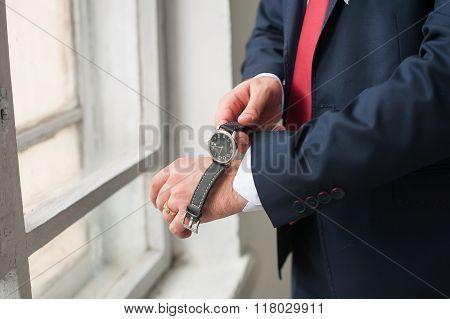 Man wears on wrist watch