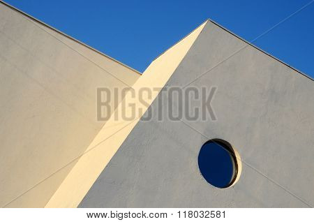 Architecture Abstract Wall With Round Window On Blue Sky Background