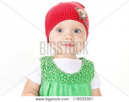 little child baby smiling portrait face eyes looking at camera hat head and shoulders studio shot isolated on white