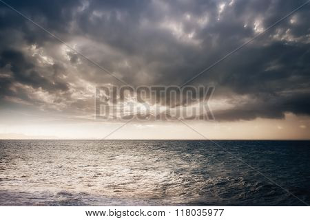 Stormy Ocean With Sunset Cloudy Sky