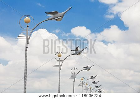 An old Thailand Gray streetlamp and blue sky