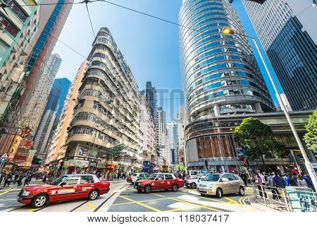 Hong Kong City With Skyscrapers And Taxi Cab