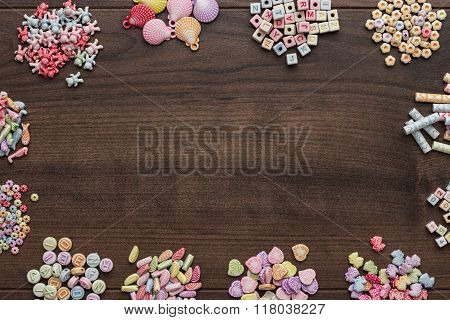 different colorful beads on the brown wooden table