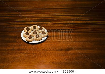 delicious homemade peanut butter chocolate drop cookies on plate on wooden table