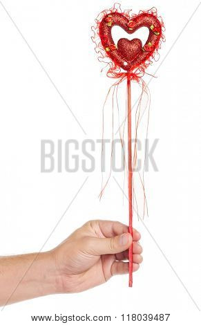 Man hand with heart on a stick with red ribbon isolated on white background