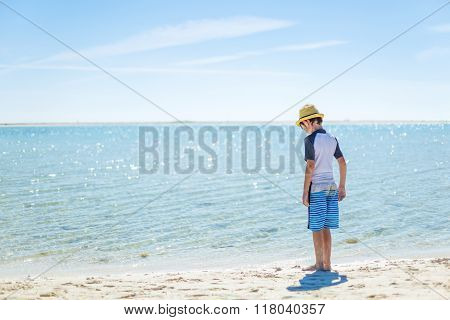 Boy relaxing on the tropical beach
