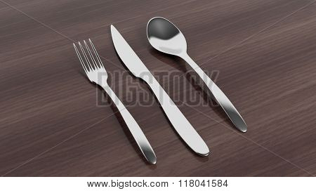 Fork, knife and spoon set on wooden surface.