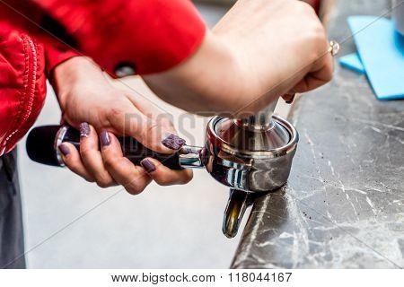 professional barista making coffee