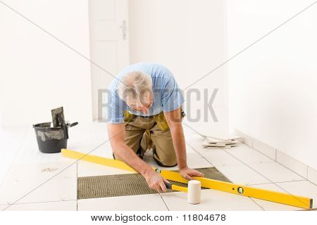 Home Improvement, Renovation - Handyman Laying Ceramic Tile