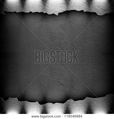 cracked concrete wall with spotlight
