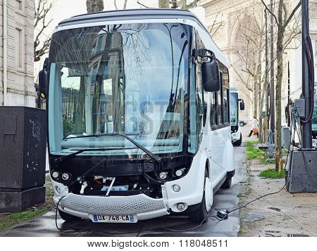 Paris, France, February 9, 2016: Electical bus  charges on the street of Paris, France