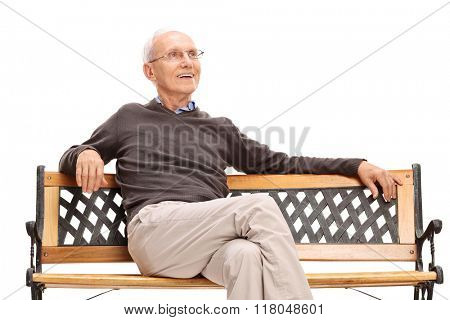 Pensive senior sitting on a wooden bench isolated on white background