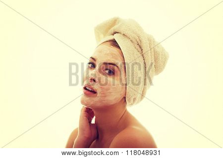 Woman with cream lotion on face