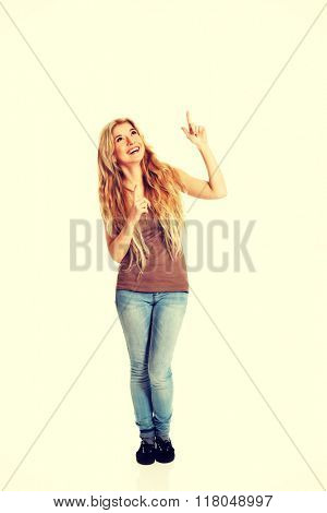 Student woman pointing up