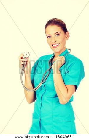 Young female doctor or nurse with stethocope