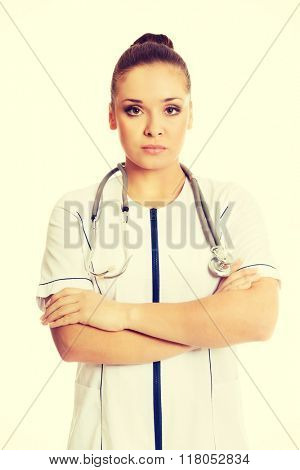 Confident female doctor with folded arms