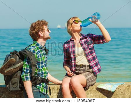 Couple Backpacker Tramping By Seaside