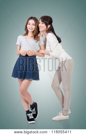 Cheerful Asian women, full length portrait.