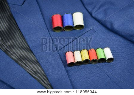 Colorful Thread In Coils On Blue Suit