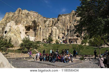 Cappadocia, Turkey - April 29, 2014: Tourists visiting Cave Church at Goreme in Nevsehir.