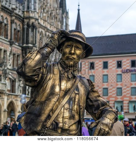 Munich, Germany - April 13, 2013: street pantomime at the marienplatz in Munich earns money as a typ